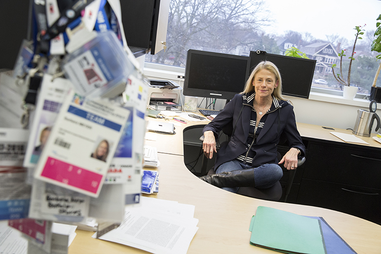 Barbara Meyer sits behind her desk in her office.