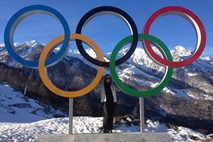 Barbara Meyer stands under the Olympic rings.