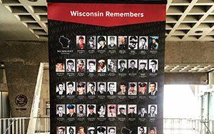 A board shows closeups of Wisconsin Vietnam war dead