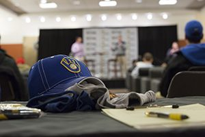 A Brewers baseball cap sits on a table.