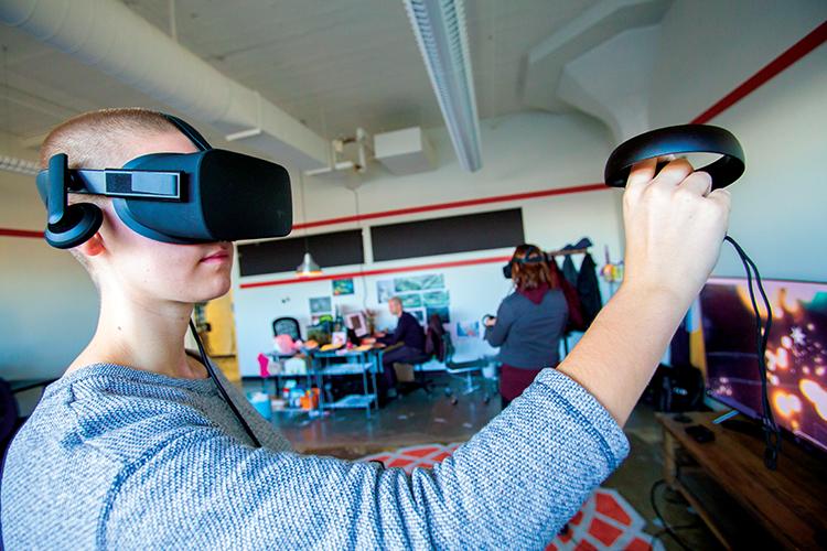 A man using virtual reality goggles