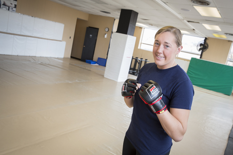 Leah Letson holding both fists in a boxer's stance before her training session begins.