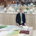 John Reuter stands in the American Geographical Society Library at UWM.