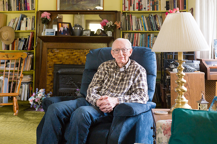 Ken Germanson sits in a chair in his home on the south side of Milwaukee.