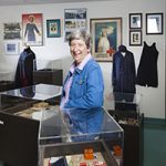 Laurie Glass leans against a display case in the nursing museum.
