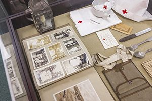 A display case includes photos, nurse clothing and other items.
