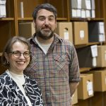 Bonnie Halvorsen and Mike Carriere stand in a room in the UWM Libraries.