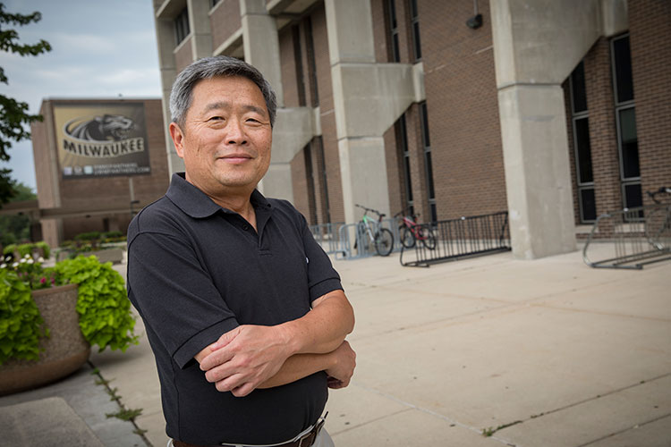 David Yu stands outside the engineering building.