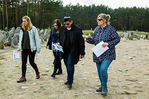 Photo of Tony Rodriguez touring the site of the Treblinka extermination camp in Poland with a group of British teachers.