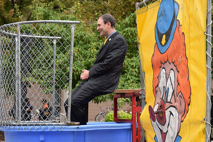 Dean Brett Peters sits in a dunk tank.