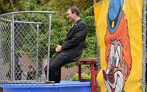 Peters sits in a dunk tank.