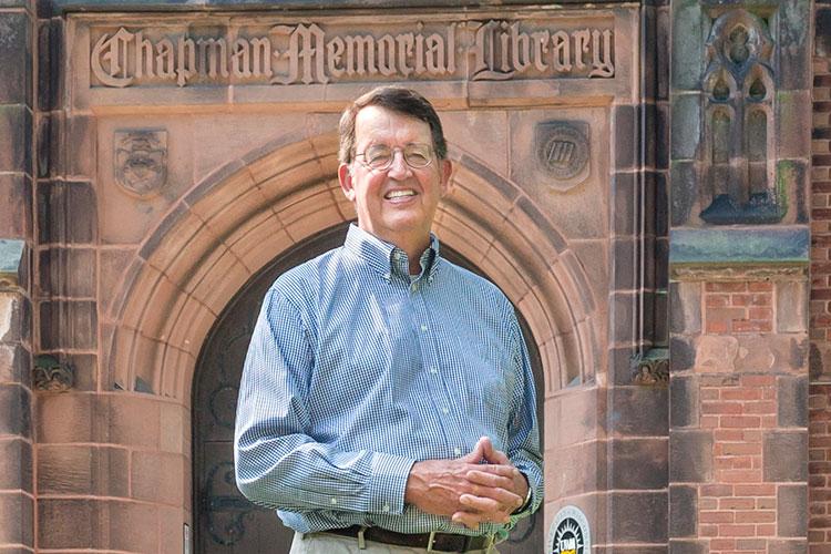 John Schroeder stands in front of Chapman Hall.