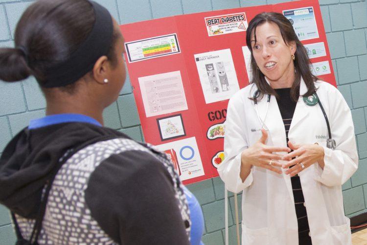 Kristie Brooke talks to a patient.