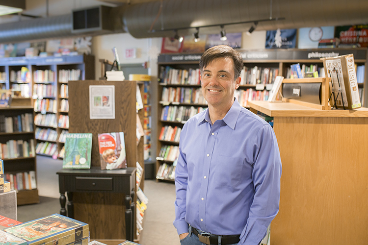 A man stands in a bookstore.