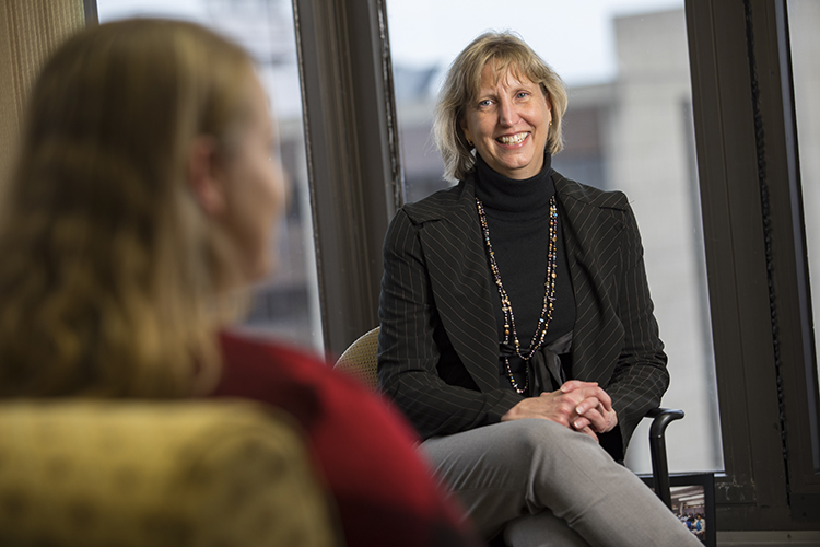 Rachel Henrichs sits and talks in the dean's office in the College of Nursing.