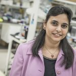 Shama Mirza stands in her lab.