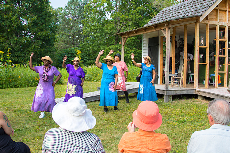 Women dance as part of Portia Cobb's play