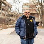 A man stands outside of the UWM Student Union.