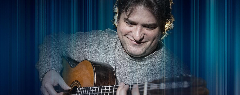 Rene Izquierdo playing a guitar