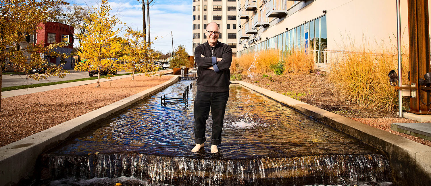 Architect James Wasley stands in Milwaukee Harbor District rainwater fountain