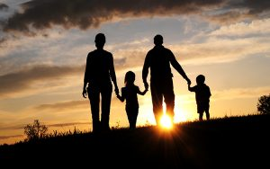 Image of a family at sunset.