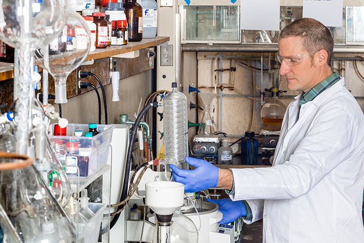 Image of graduate student working in lab