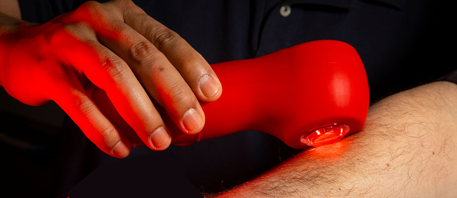 Image of a hand applying light therapy