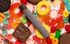 Image of e-cigarettes surrounded by candy
