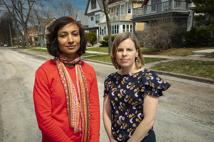 Two women pose stand in a Milwaukee neighborhood.
