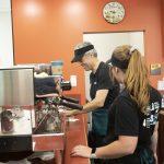Chancellor Mark Mone making espresso