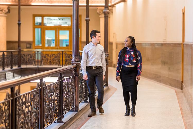 Tiffanie Cobb walking with colleague