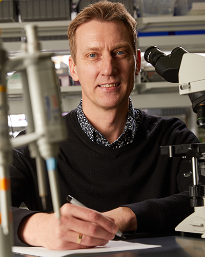 Researcher poses for photo in lab