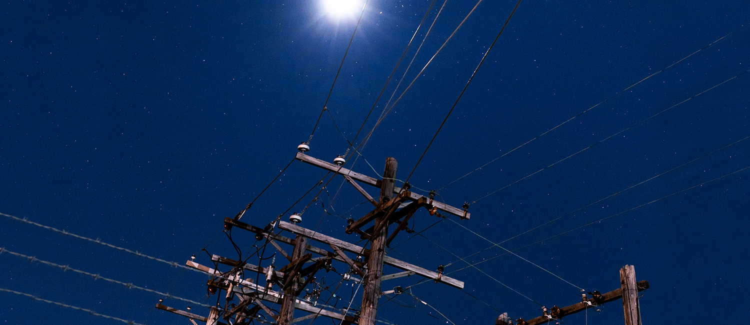 Utility pole against a blue sky