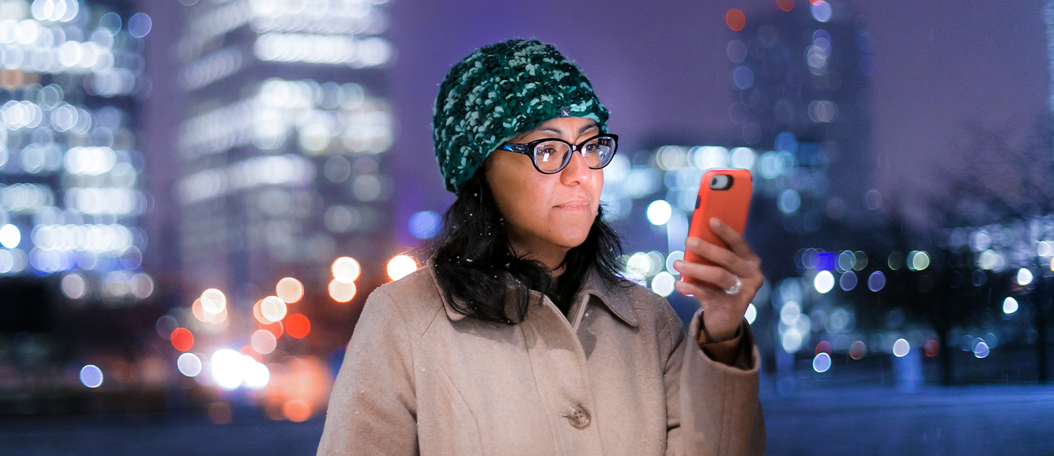 Image of researcher Celeste Campos-Castillo looking at her cellphone.