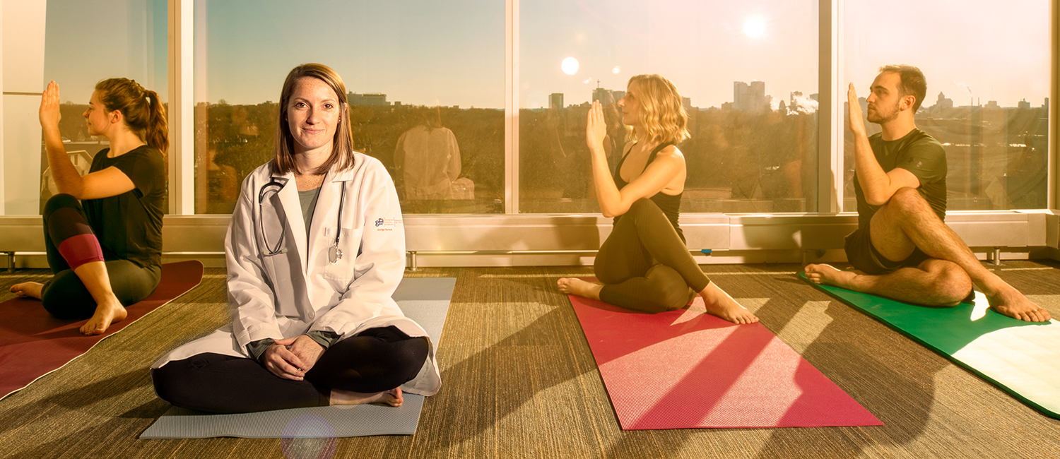 Photo illustration of researcher sitting on yoga mat next to three people doing yoga.