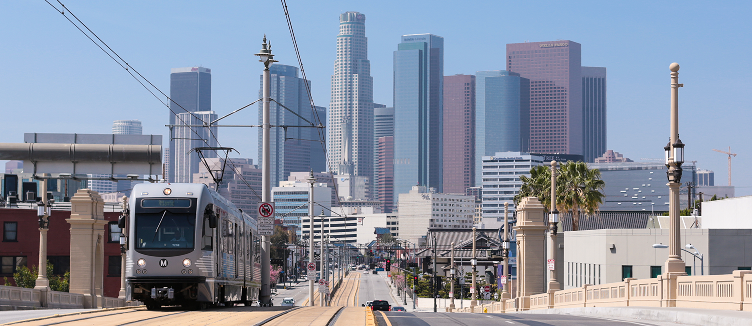 Los Angeles light rail train with downtown in background