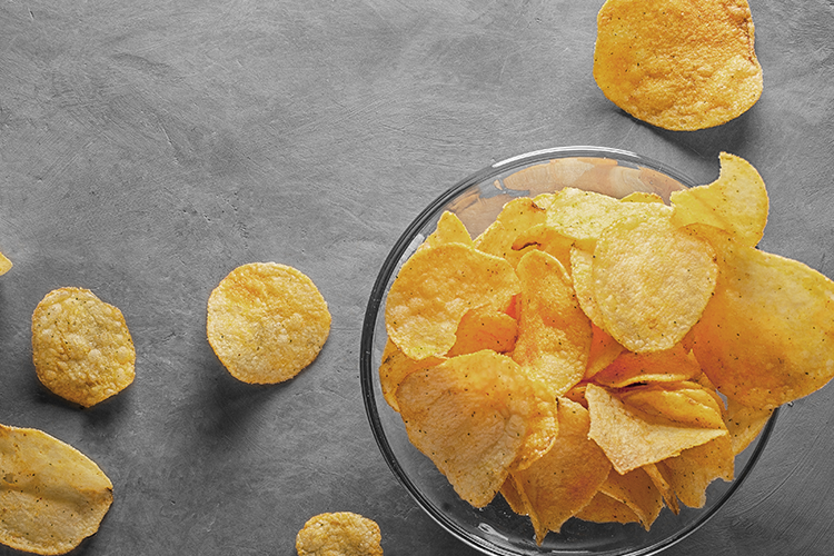 Image of potato chips in a glass bowl