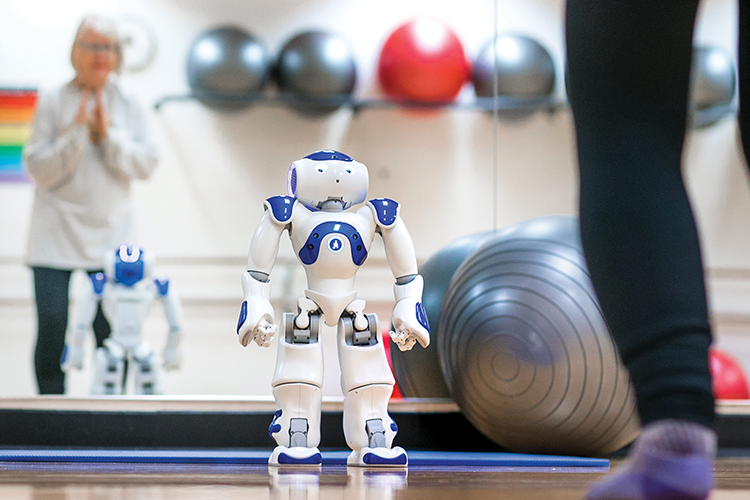 Eye-level with a small robot in a fitness space with exercise balls