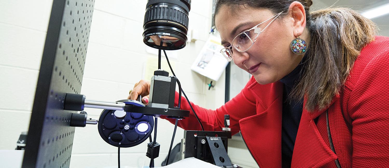 Professor Masha Ranji looks at cells with fluorescent imaging tech