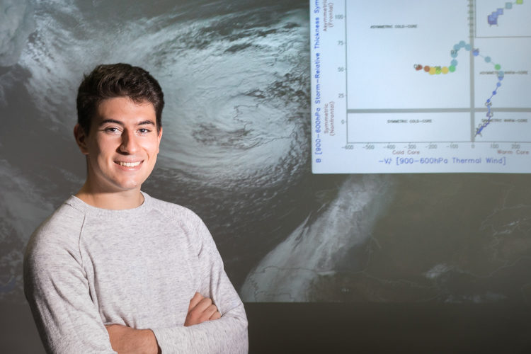 UWM student Giorgio Sarro in front of storm projection