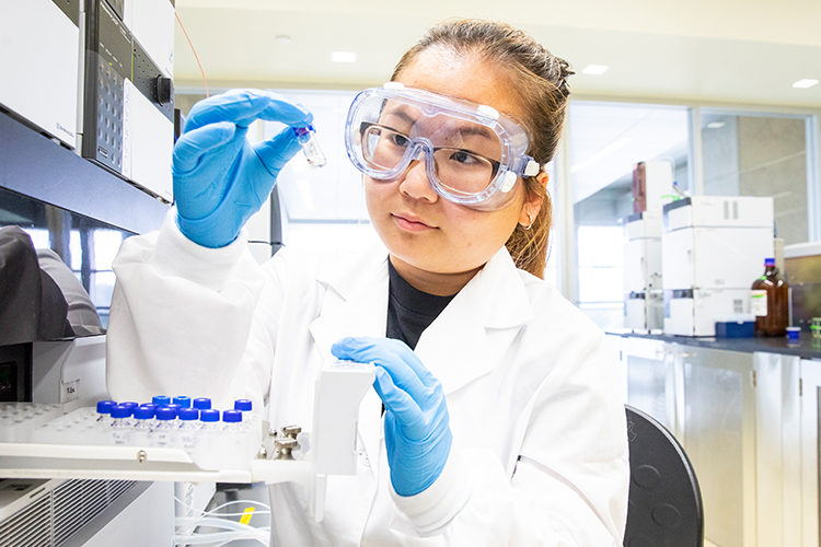UWM undergrad researchers Maixee Yang in a lab