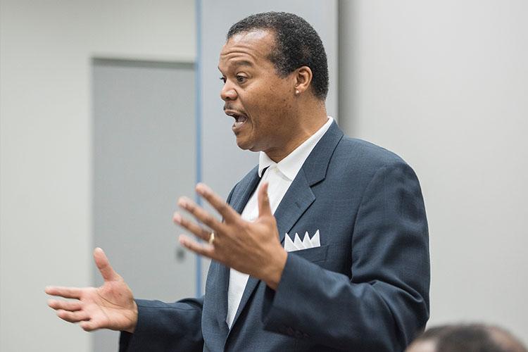 Kirk Harris speaking at a meeting