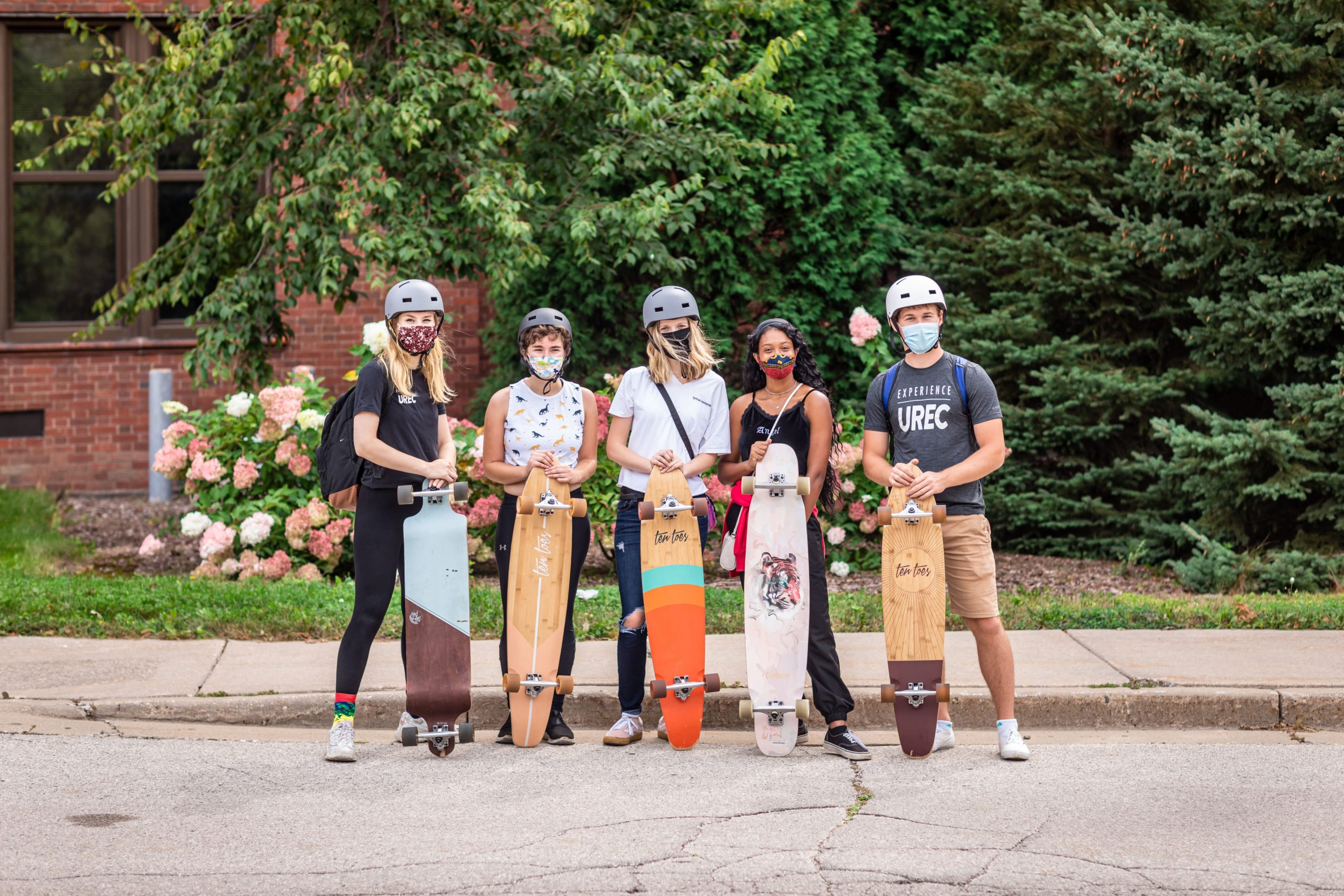 students with longboards