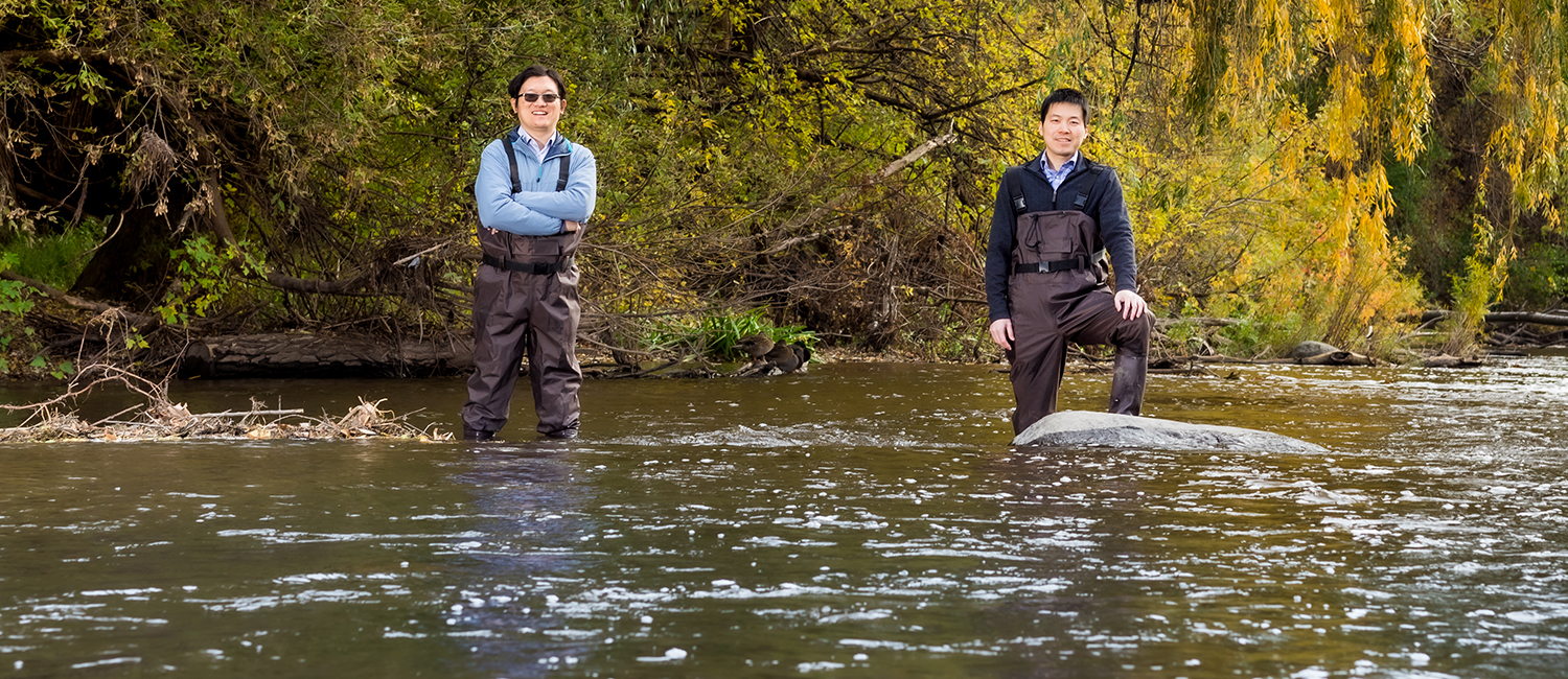 Two UWM researchers standing in river