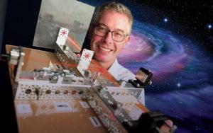Patrick Brady shows off a model of LIGO