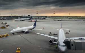Several airplanes at airport docking area