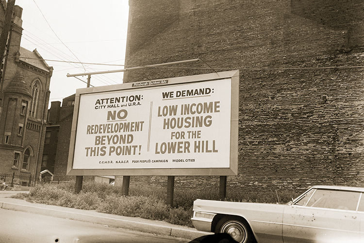 A black-and-white photo of a billboard.
