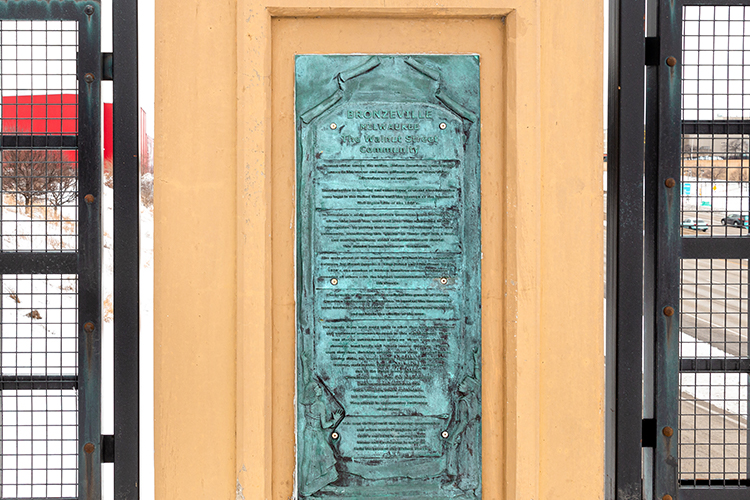 Photo of a plaque on a bridge.