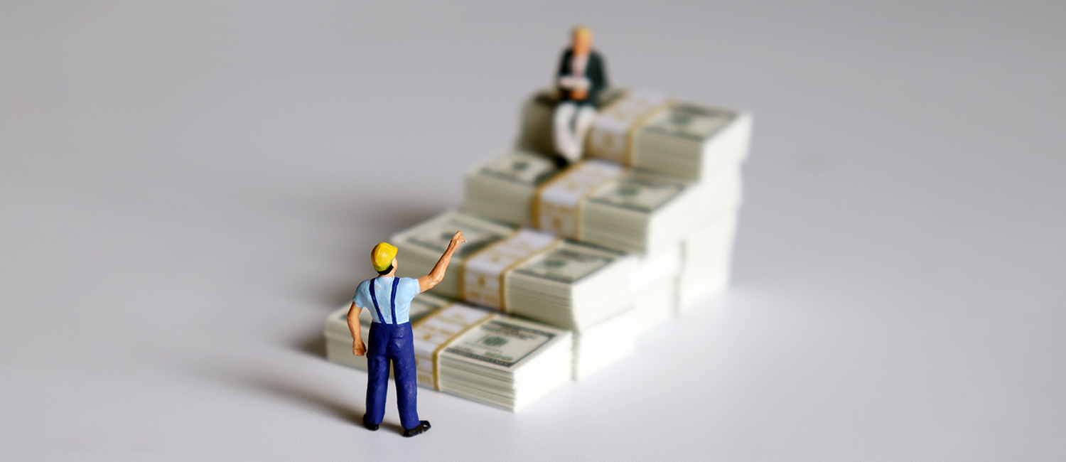 Illustration of two miniature figures of workers and stacks of cash.