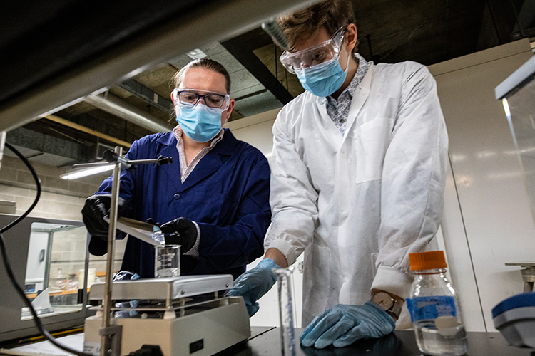 Two doctoral students in UWM research Sobolev's lab